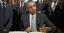 ObamaSigningBill