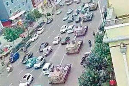 PLA tanks pass through Yanji near the China-North Korea border.
